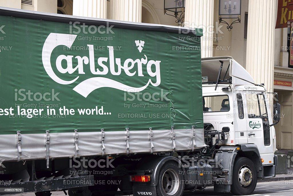 Green Carlsberg truck parked in London street stock photo