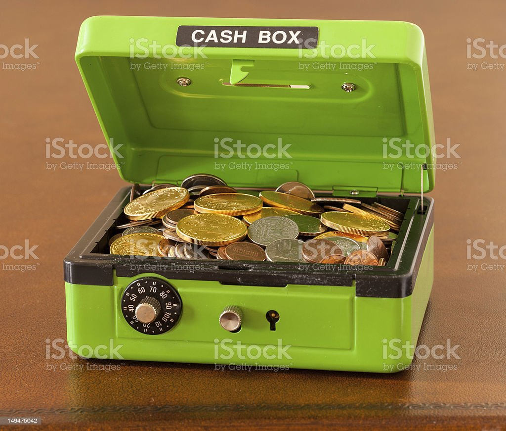 Green cash box with gold and silver coins stock photo