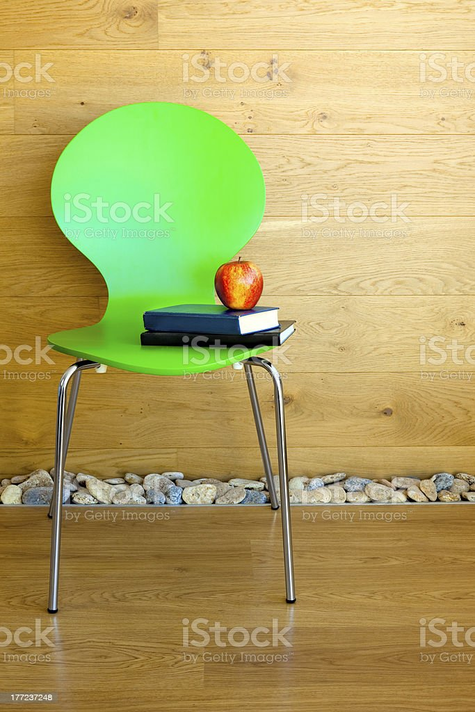 Green Chair, Red Apple and some Books royalty-free stock photo