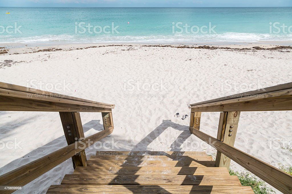 Green chairs and blue summer beach house. stock photo