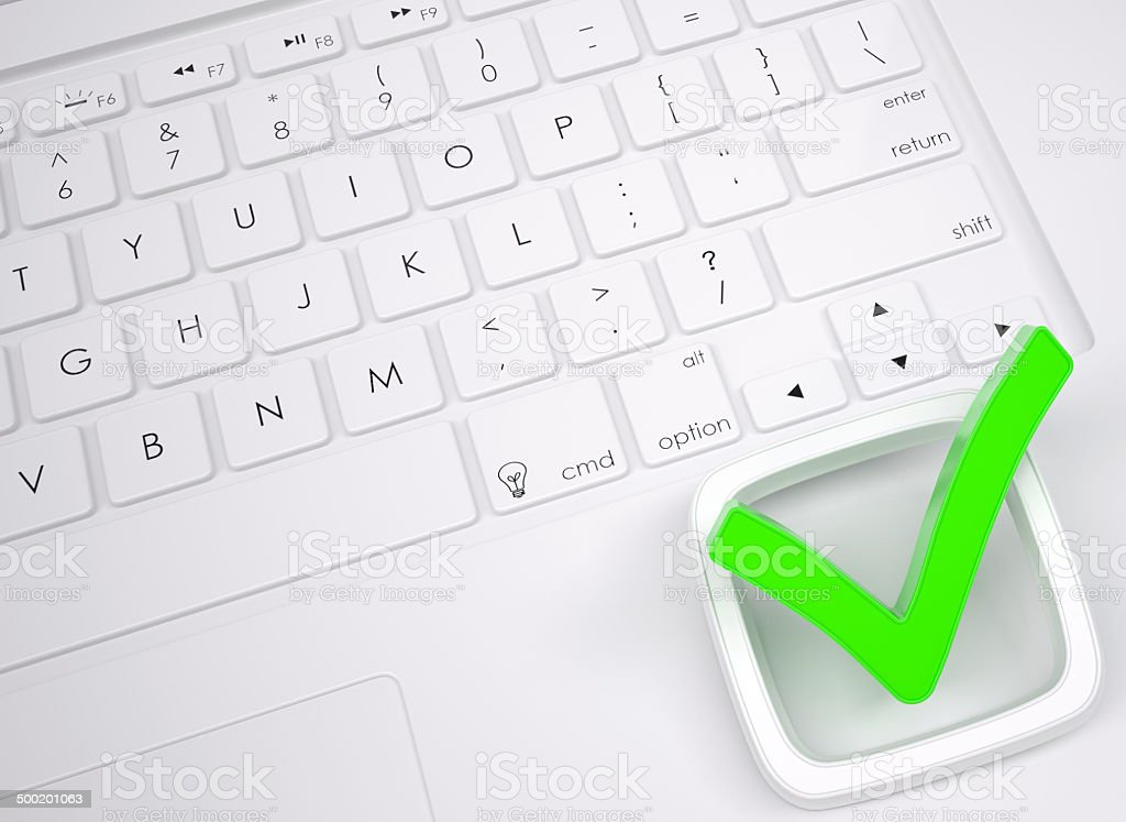 Green check mark on the keyboard stock photo