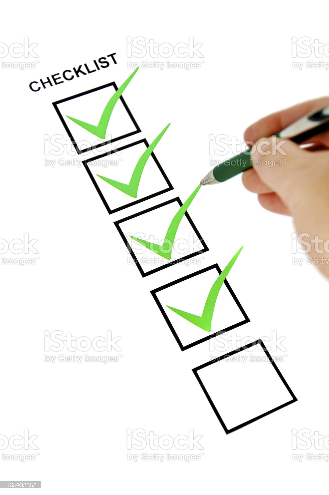 Green checklist with pen holding hand. royalty-free stock photo
