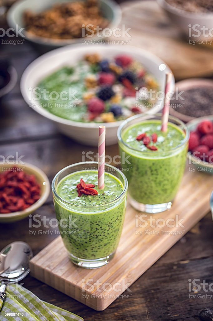 Green Chia Smoothie in Glsas with Superfoods Goji on Top stock photo