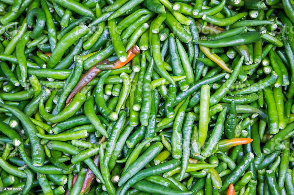 Green chillies for sale at market,Thailand royalty-free stock photo