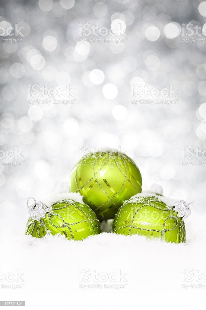 Green christmas balls arranged in pyramid against blurred lights royalty-free stock photo