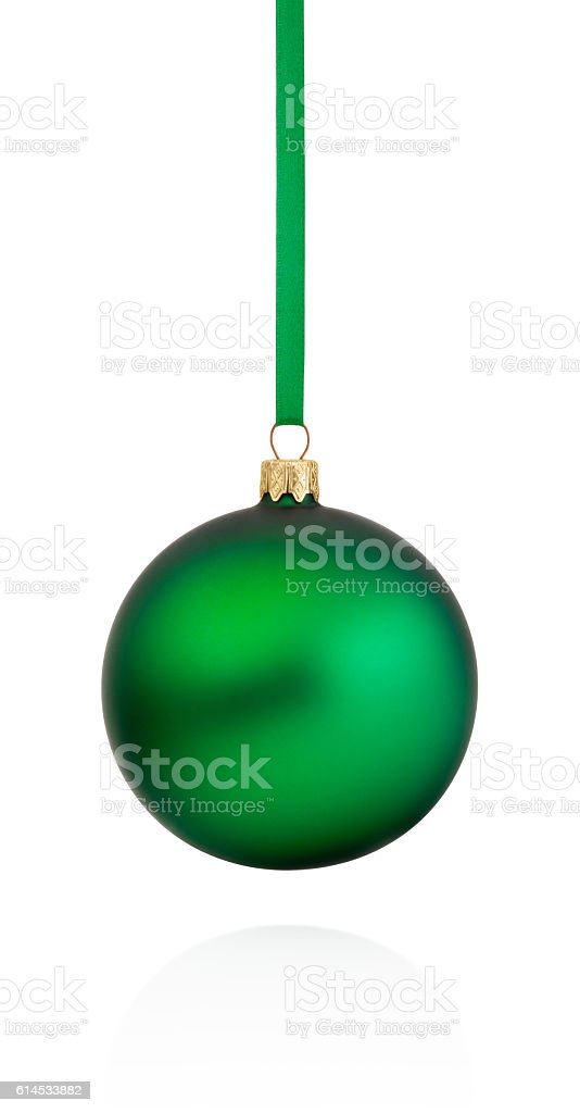 Green Christmas bauble hanging on ribbon Isolated on white background stock photo