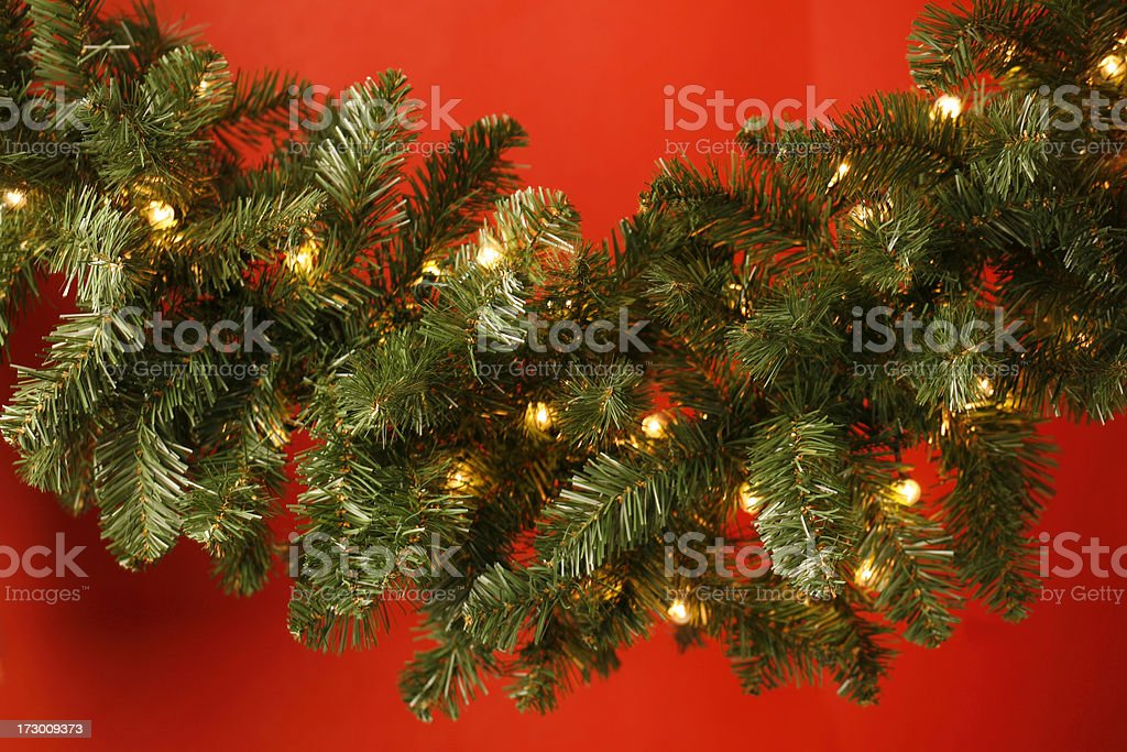 Green Christmas garland with yellow lights royalty-free stock photo
