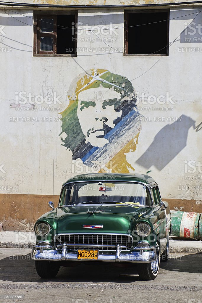Green Classic Cuban Car and Che mural stock photo