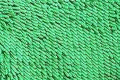 Green cleaning feet doormat or carpet texture