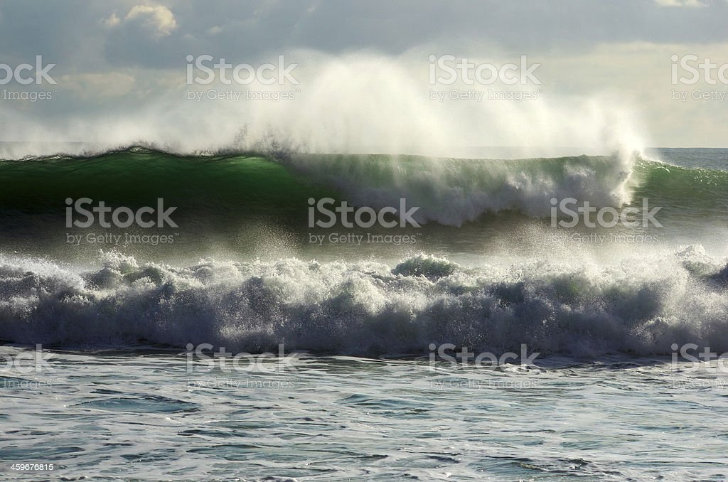 Green clear sunlit wave stock photo