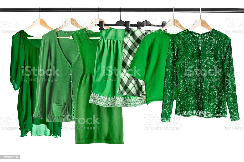 Green clothes on clothes rack stock photo