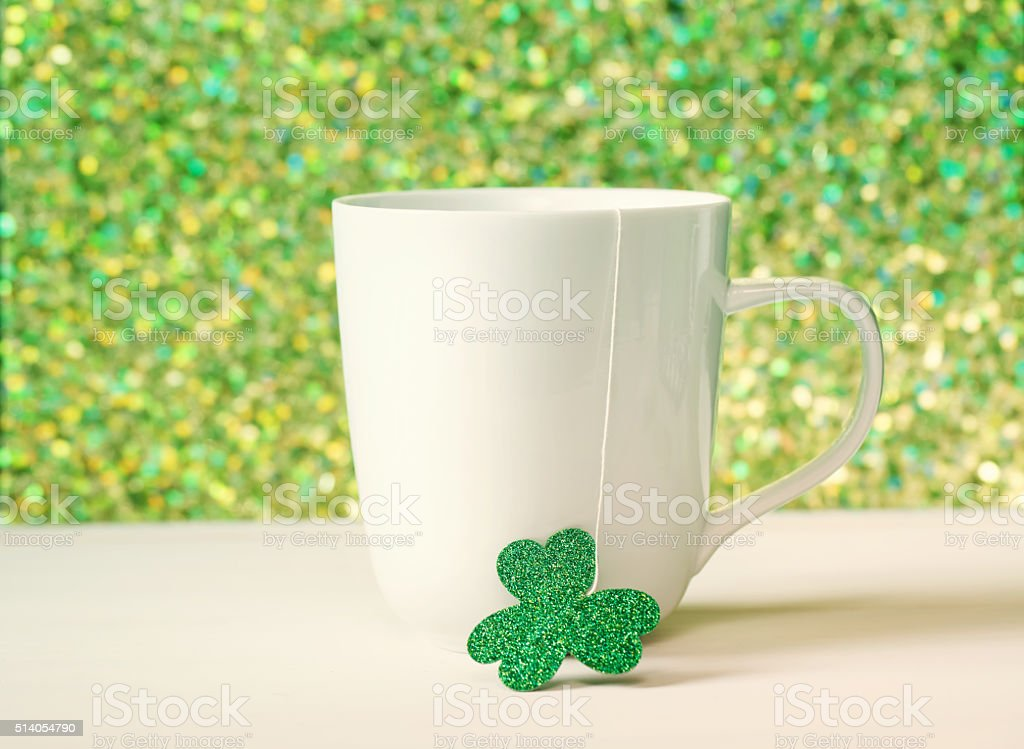 Green clover with white mug stock photo