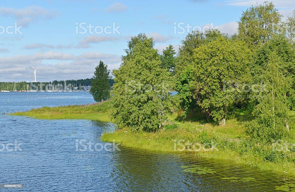 Green coastline in Oulu stock photo
