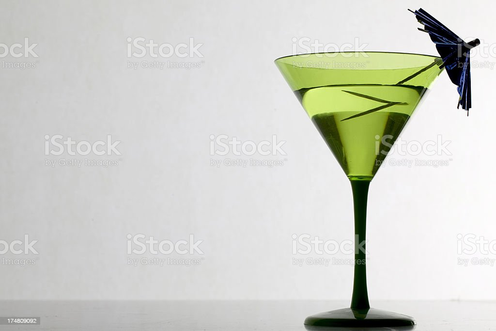 Green cocktail glass with umbrella. royalty-free stock photo