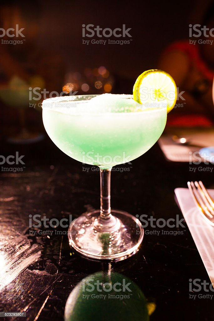 green cocktail in wineglass. stock photo