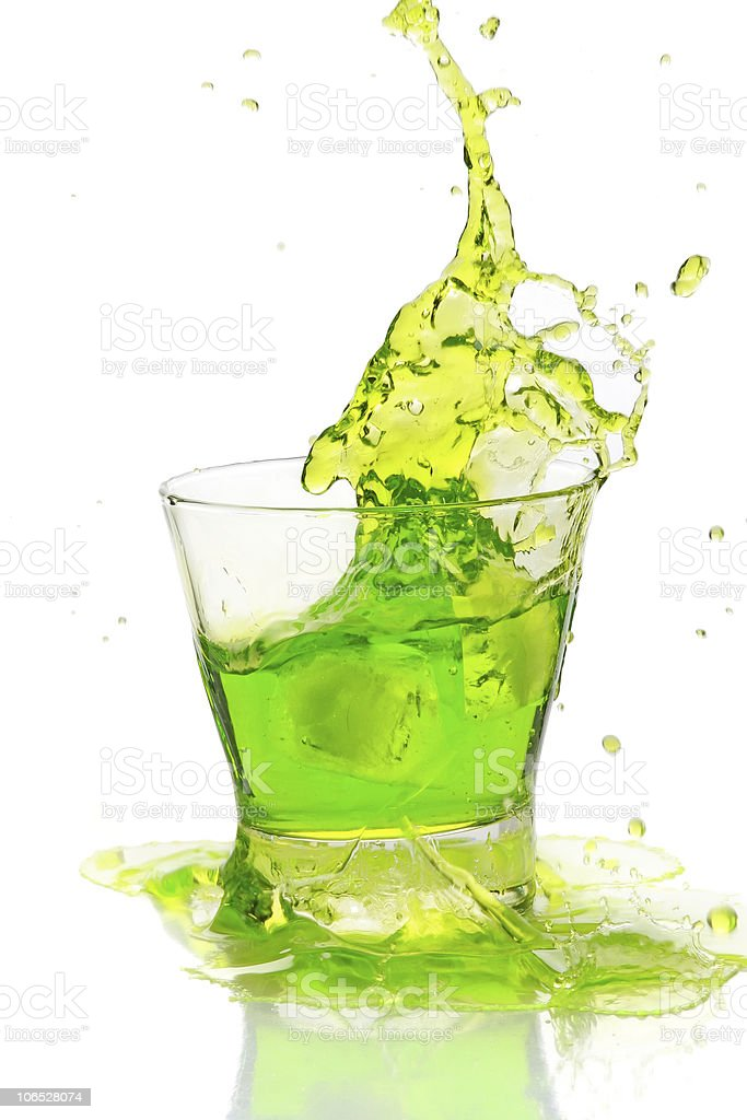 Green cocktail splashing stock photo