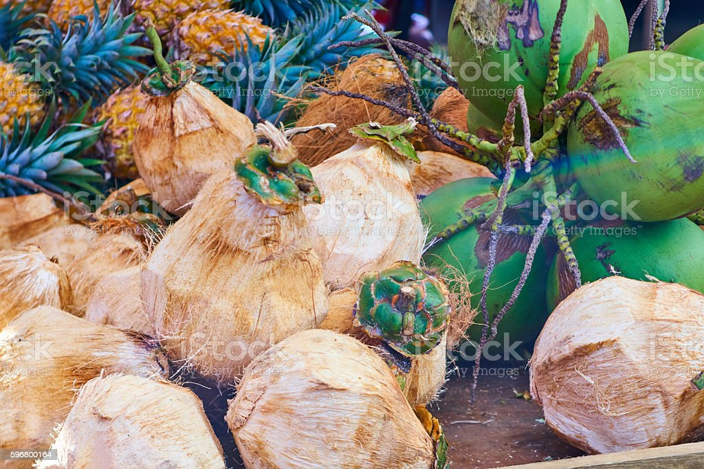 Green coconuts in the market stock photo