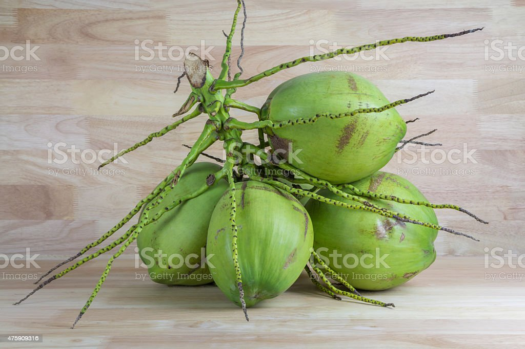 Green coconuts on wood background royalty-free stock photo