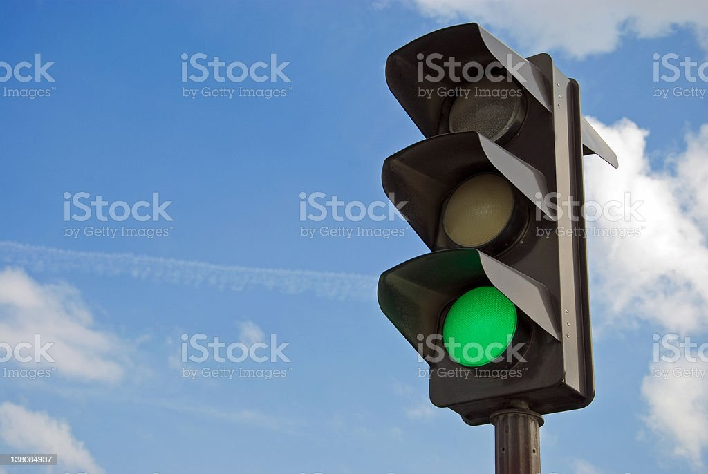 Green color on the traffic light stock photo