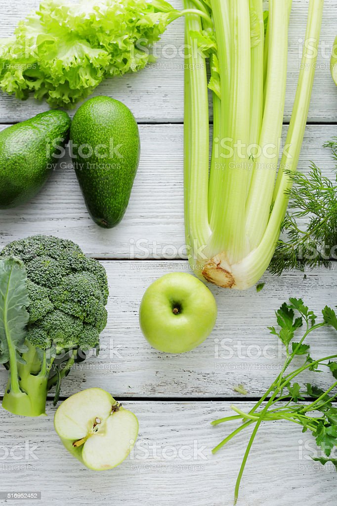 green color vegetables on white rustic boards stock photo