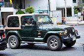 Green colored Wrangler Jeep 4.0L