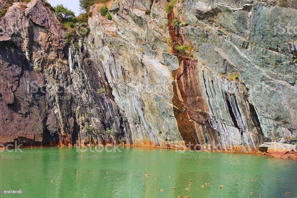Green copper lake in Visnes, Norway. stock photo