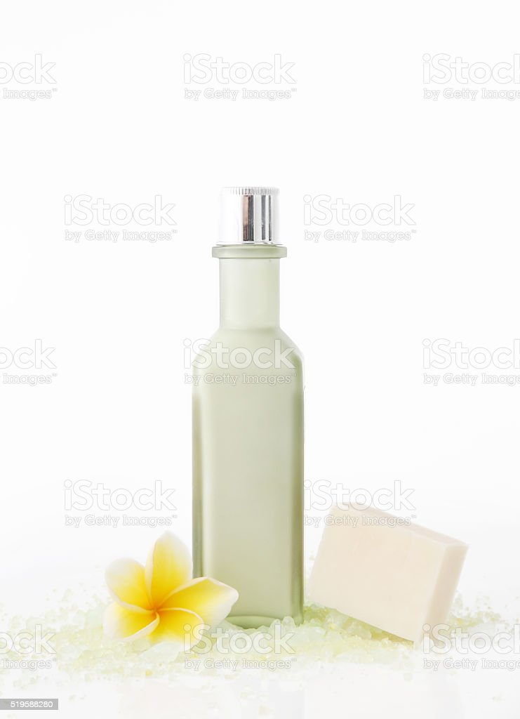 Green cosmetic bottle with soap bar stock photo