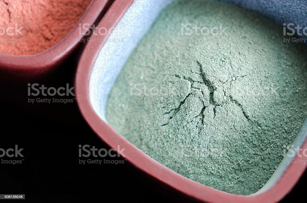 Green cosmetic clay powder stock photo