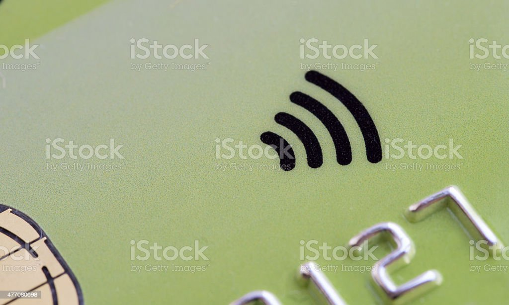 Green Credit card with contactless symbol stock photo