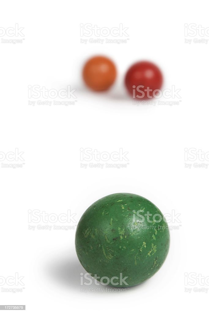 Green Croquet Ball with Two Red and Orange Behind stock photo