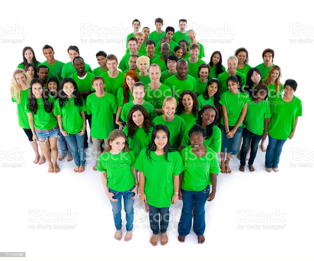Green cross formed by group of multi-ethnic people stock photo