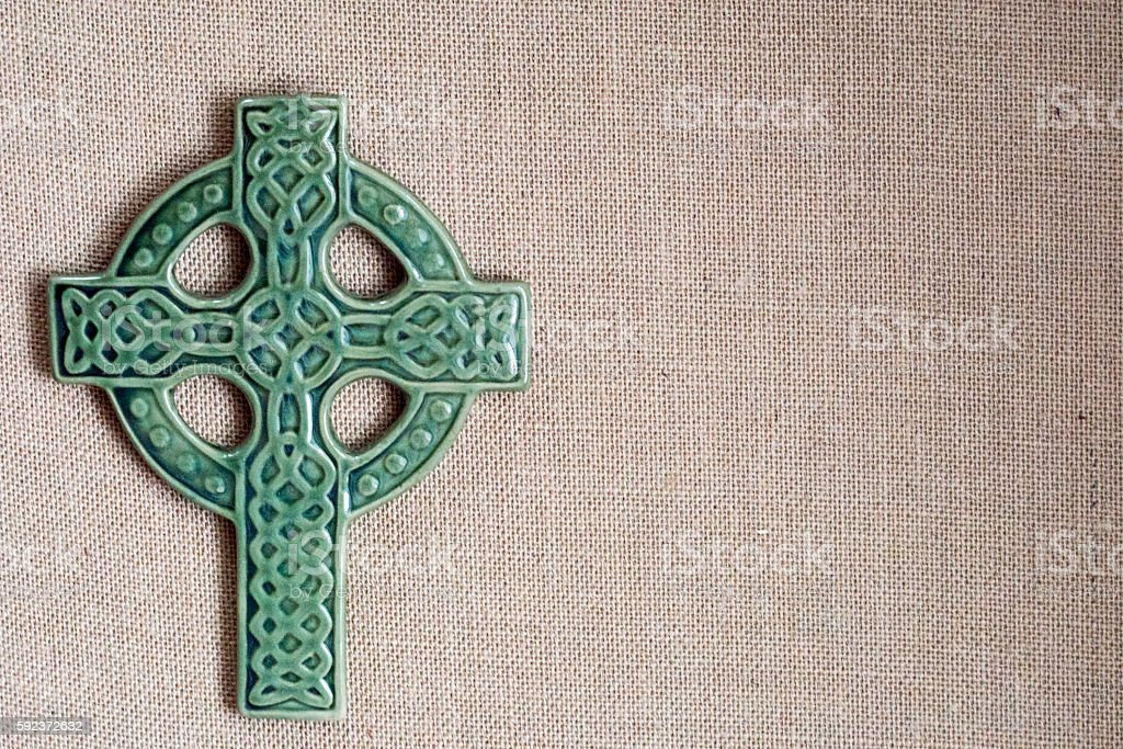 Green Cross on burlap background stock photo