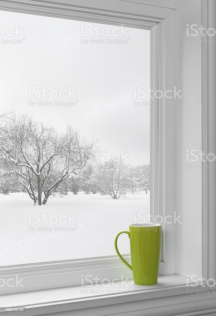 Green cup on a windowsill stock photo