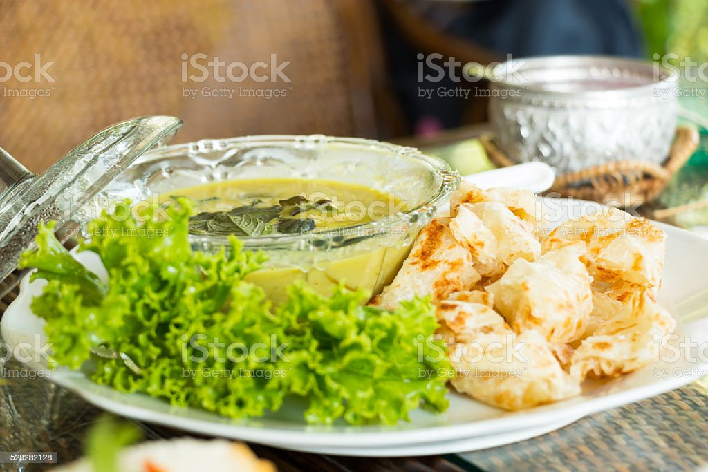 green curry and roti. stock photo