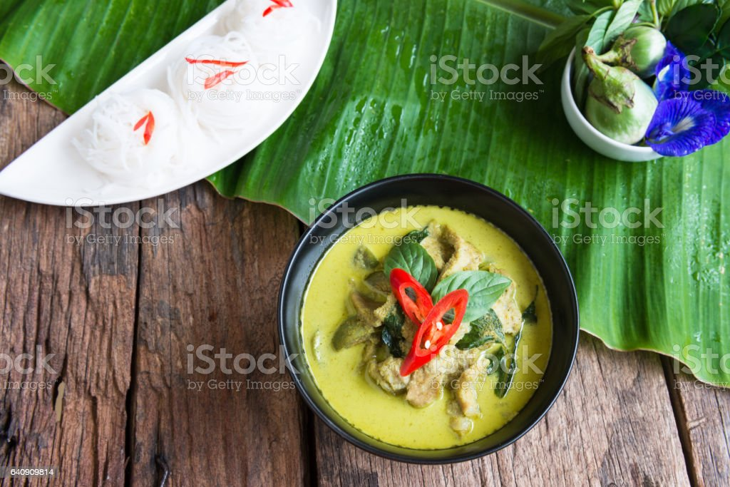Green curry creamy coconut milk with chicken stock photo