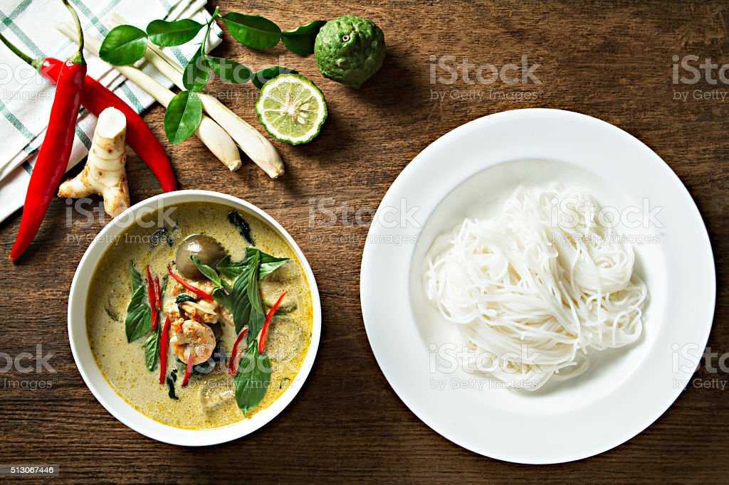 Green curry with shrimp and rice noodles. Thai cuisine. stock photo
