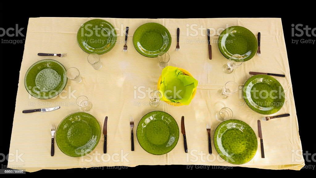 Green cutlery set on table ready for food to be served isolated on black. stock photo