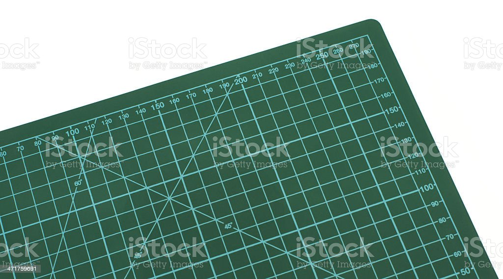 green cutting mat on a white background royalty-free stock photo