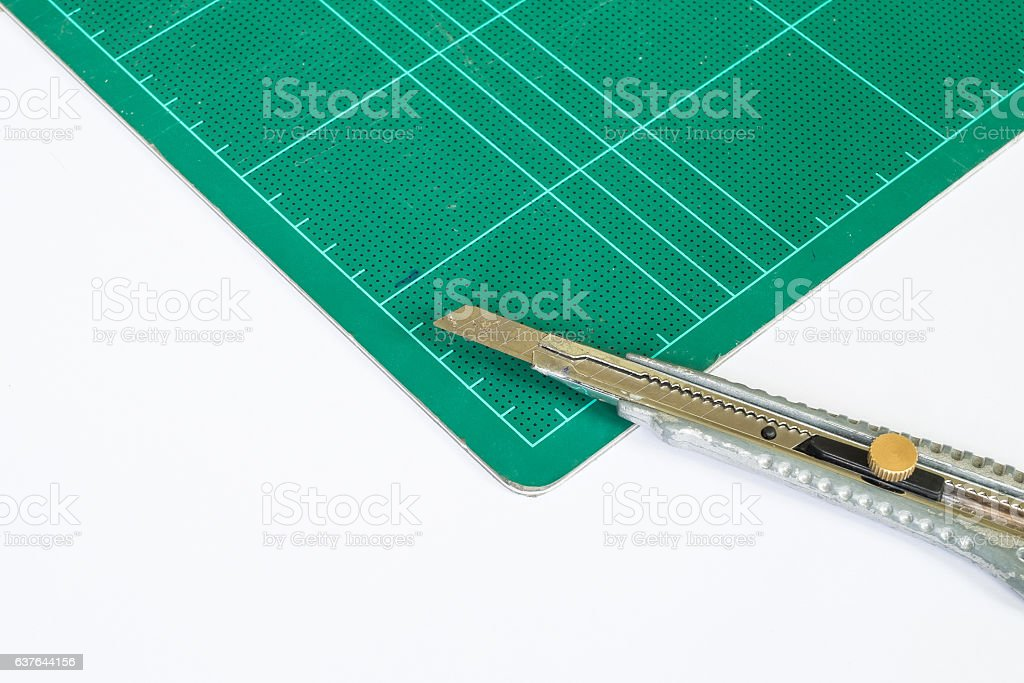 green cutting mat with cutter stock photo