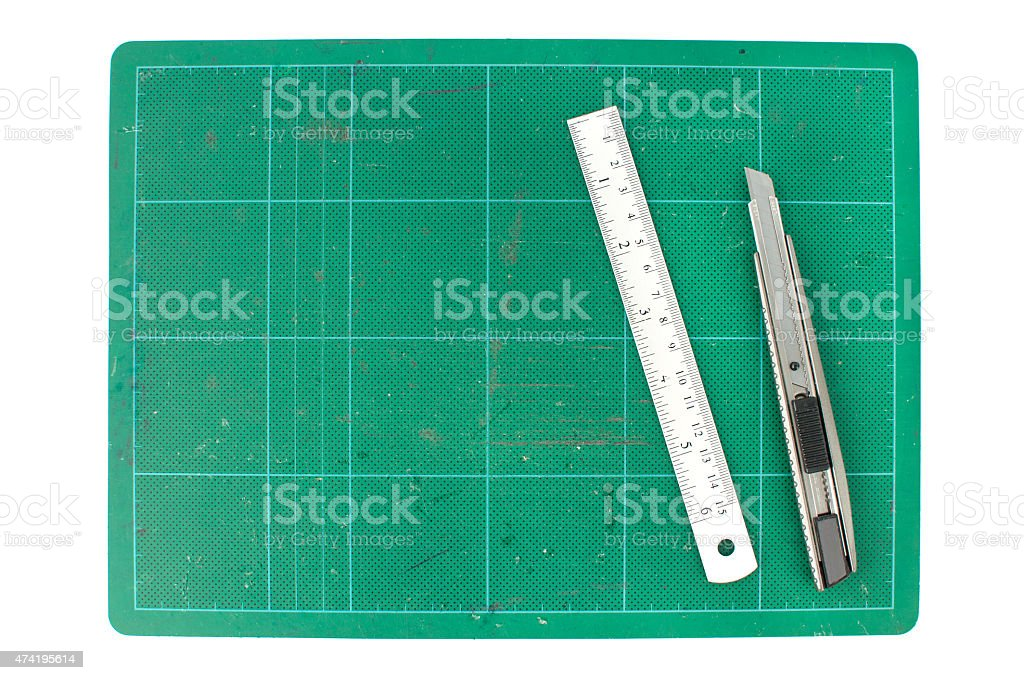 Green cutting mats with ruler and cuter on white background stock photo