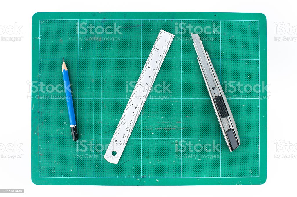 Green cutting mats with ruler pencil and cuter stock photo