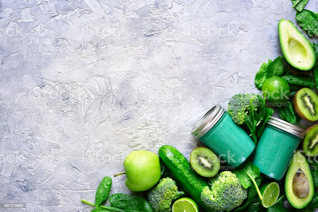 Green detox smoothie on a grey slate,stone or concrete background stock photo
