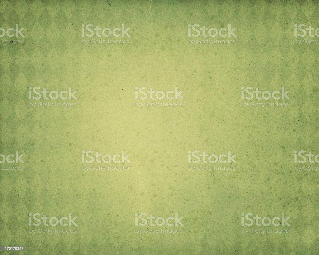 green diamond pattern worn paper stock photo