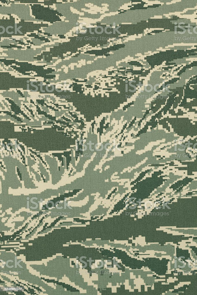 Green digital tigerstripe camouflage fabric texture background stock photo