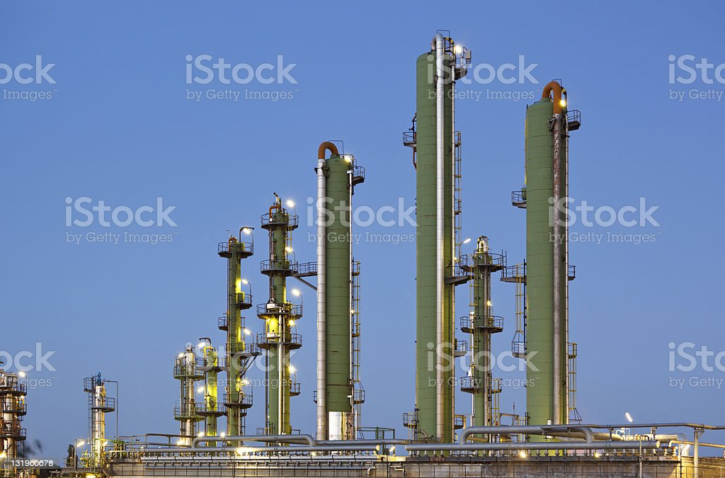 Green Distillation Towers At Dusk royalty-free stock photo