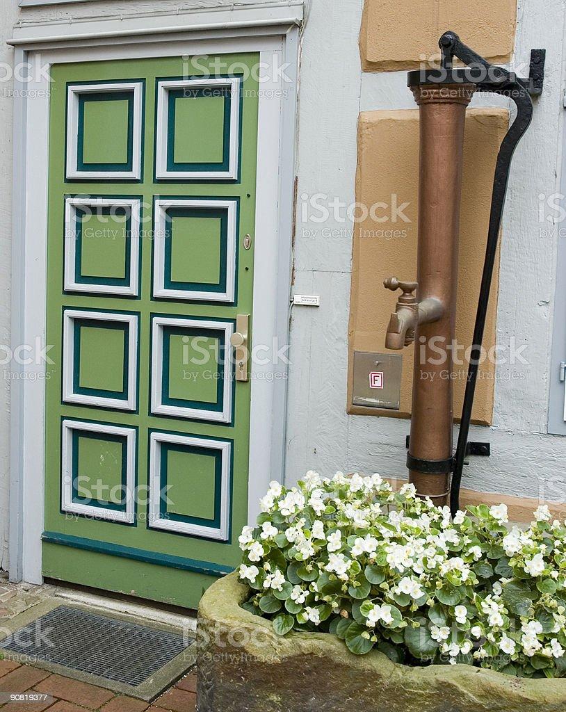 Green Door & water pump stock photo