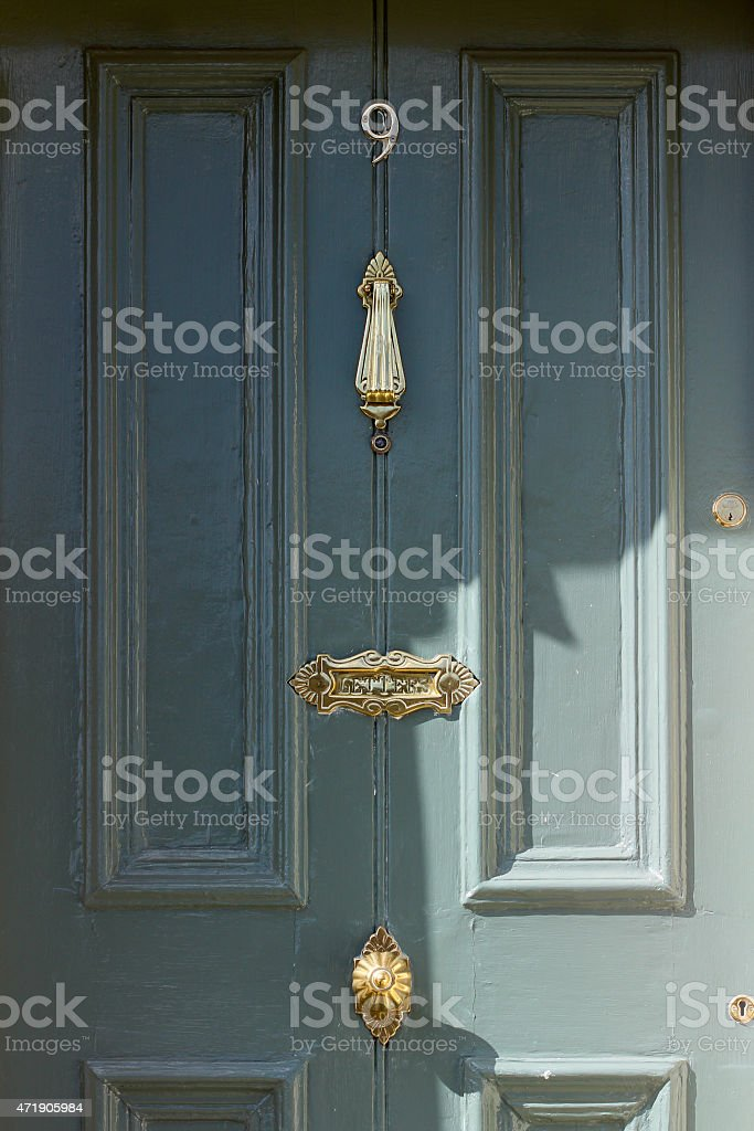 Green Door with bronze ornaments stock photo