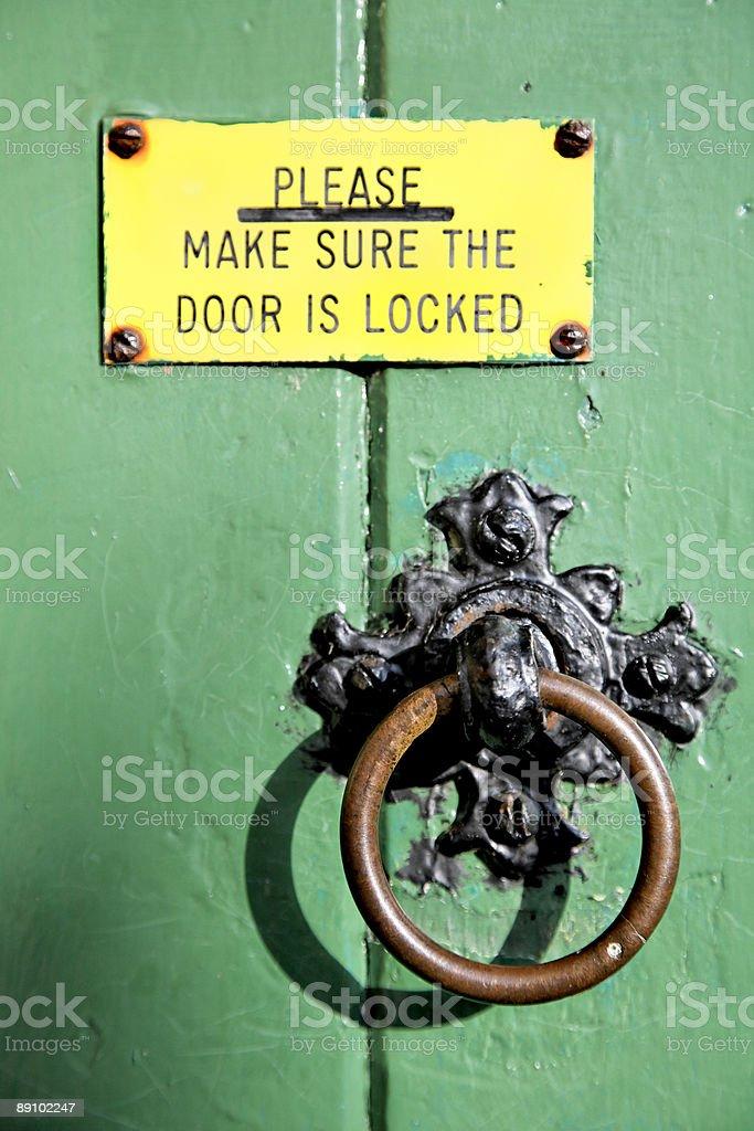 Green Door with Sign-Alternative view below... royalty-free stock photo