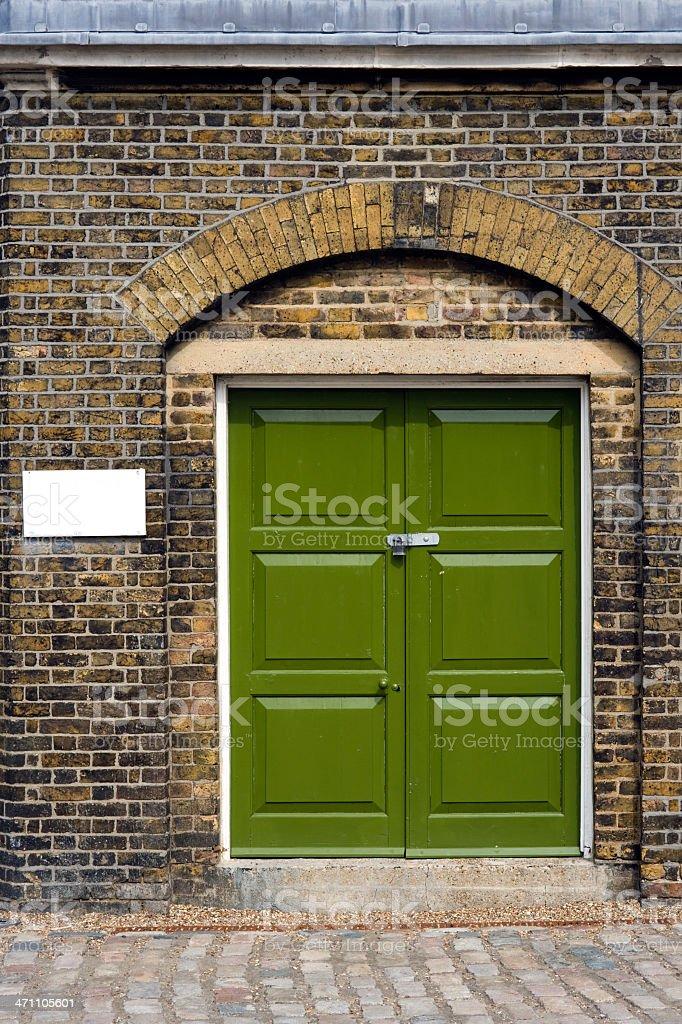 Green doors stock photo