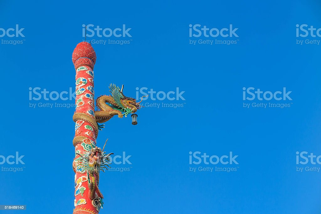 Green dragon statues on red pole at Chinese Temple stock photo